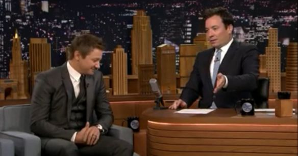 Jeremy Renner in a 3 pc suit with Jimmy Fallon
