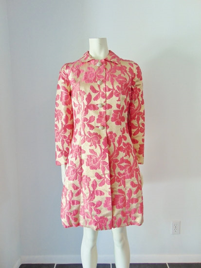 Vintage '60's gold and pink evening coat.  Most Etsy sellers will tell you if there is any damage to a vintage item.  See this page  for a closer look